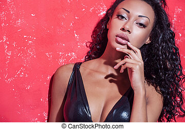Glamour fashion model. Beautiful young Afro-American woman...