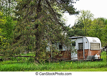 The Simple Life - Rusty old camper in the campground.