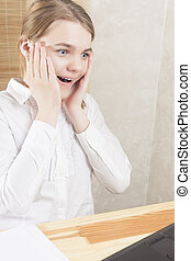 Portrait of Surprised Chatting Teenager Girl. Vertical Image...