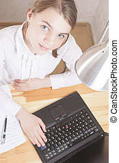 Teenage Girl Working With Laptop Vertical Image