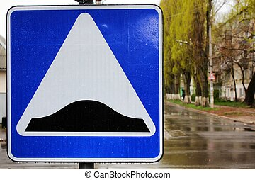 Speed bump sign - A close-up photo of speed bump sign at...