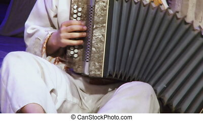 Bayan - Russian man in national dress playing accordion