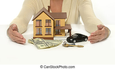 Hand holding small car - Real estate concept. woman hand...