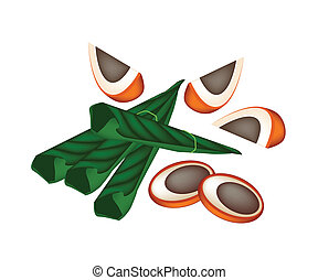 Ripe Areca Nuts and Betel Leaves on White Background