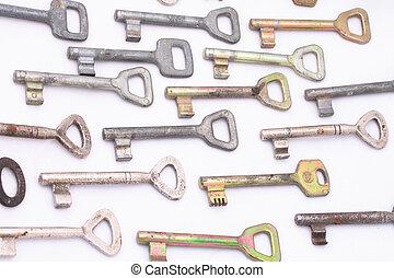 keys - many old keys on the white background