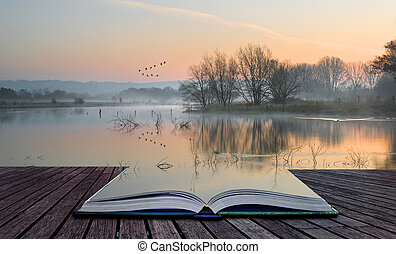 Book concept Landscape of lake in mist with sun glow at...