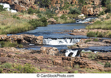 waterfall at the bourkes potholes in south africa - river at...