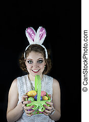 Woman with rabbit ears and basket - Young woman posing with...