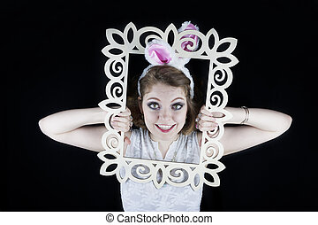 Woman with rabbit ears and frame - Young woman posing with...