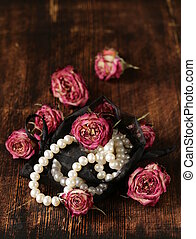 Vintage pearl with dry roses