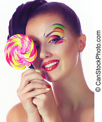 girl with pink spiral lollipops - Beautiful young girl with...