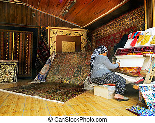 Carpet weaving - Turkish women are engaged in carpet weaving