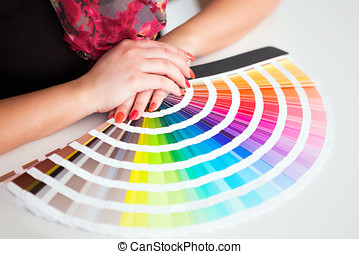 Graphic designer working with cmyk palette in studio