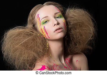 Fashion portrait of young girl bedraggled with colorful dye