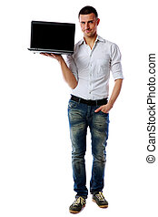 Full-length portrait of a happy man with laptop over white...