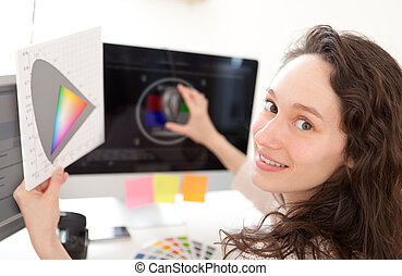 Woman photographer calibrate her screen - View of a Woman...