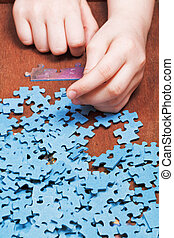 assembling of jigsaw puzzles