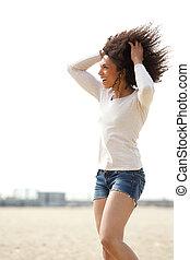 Woman enjoying summer at the beach - Portrait of a beautiful...