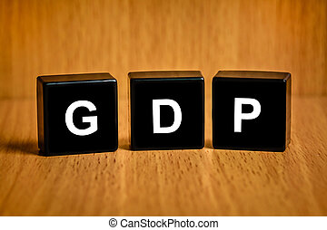 gross domestic product or GDP word on black block - gross...