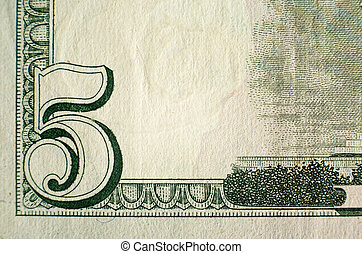 Five Dollar Bill - A close up on a five dollar bill Shallow...