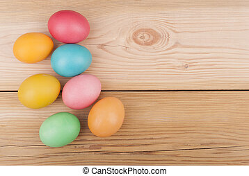 Easter eggs on wooden background.