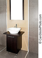 Contemporary lavatory with brown cabinet and mirror