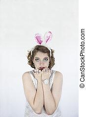 Woman wearing rabbit ears