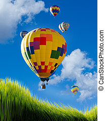 Hot Air Balloons. - Hot air bolloons flying high over green...