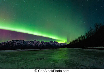 Northern Lights - Northern lights over a frozen river.