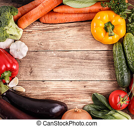 Vegetables on wood background with space for text Organic...