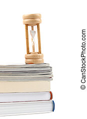 Hourglasses and book isolated