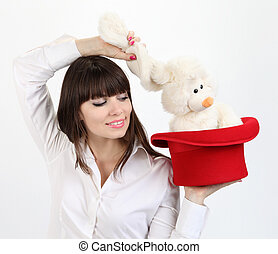 woman with rabbit in top hat