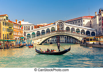 Rialto Bridge in Venice - Gondola near Rialto Bridge in...