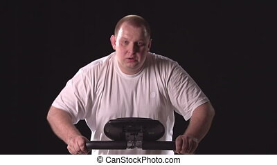 Jogging to Lose Weight - Chubby man jogging on treadmill