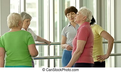 Before Class - Ladies in sportswear talking to each other