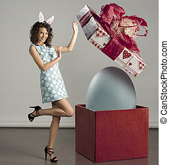 smiling woman with easter big box - very cute young woman in...