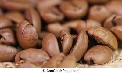 Macro Coffee beans - Handful of coffee beans on a rotating...