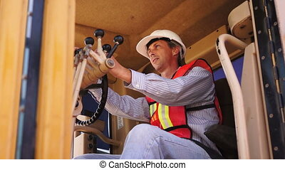 Industrial Male Road Grader Smile - Male in white hard hat...