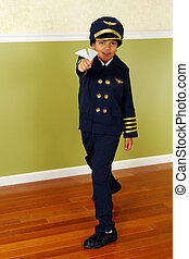 Wanna\'be Pilot - An elementary boy flying a paper airplane...