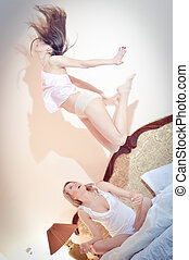 Levitation is her new level in yoga - Two beautiful happy...