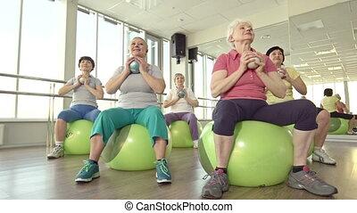 Swiss Ball Exercise - Dolly shooting of senior women...