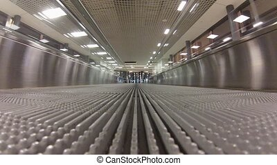 Empty Travelator in airport, reverse way