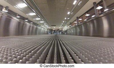 Empty Travelator in airport, reverse way