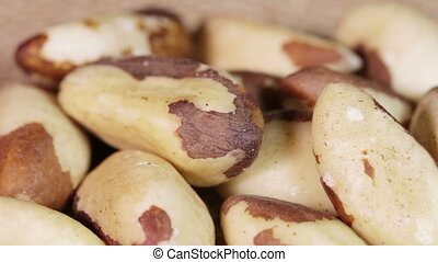 Close up Brazil nut - Handfuls of Brazil nut on rotating...