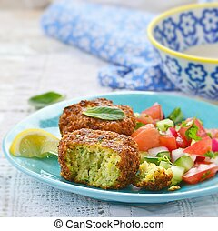 falafel with tehina  sauce and vegetable salad