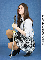Girl with sword sit on a blue background