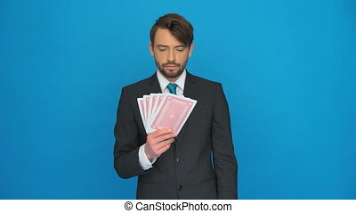 handsome businessman holding cards - handsome businessman...