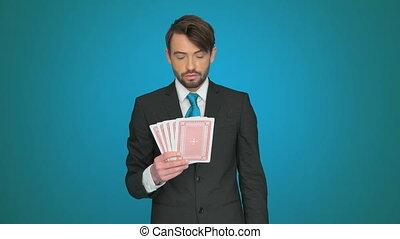handsome businessman holding cards - handsome businessman...