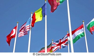 national flags of various countries fluttering in the wind...