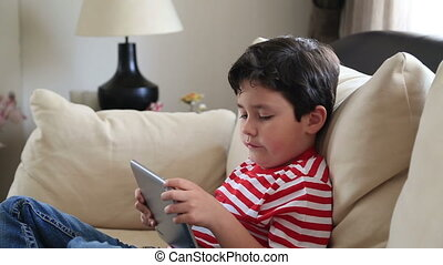 little boy with digital tablet 3 - Child Using a Touch...